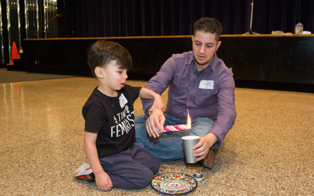 An inter-generational Hannukah celebration hosted by Keshet, a national Jewish LGBTQ equality group. (Collin Howell/Flickr)