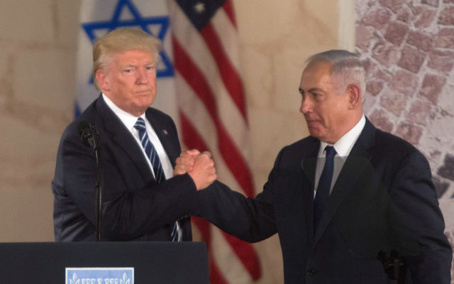 President Donald Trump and Prime Minister Benjamin Netanyahu shake hands during a visit to the Israel Museum in Jerusalem, May 23, 2017. Getty Images