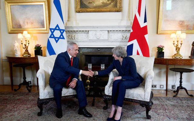 Britain's Prime Minister Theresa May welcoming Israel's Prime Minister Benjamin Netanyahu to 10 Downing Street in London, June 6, 2018. (Toby Melville – WPA Pool/Getty Images)
