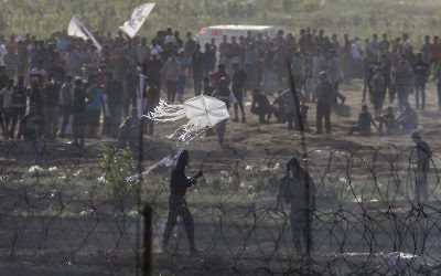 Palestinians protesting by the Israel-Gaza border during long day of clashes with Israeli troops, June 8, 2018. JTA