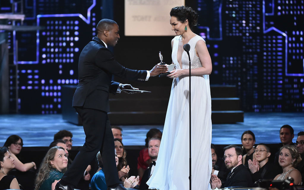 Leslie Odom Jr. presents Katrina Lenk the award for Best Performance by an Actress in a Leading Role in a Musical for The Band's Visit onstage during the 72nd Annual Tony Awards at Radio City Music Hall on June 10, 2018 in New York City. Getty Images