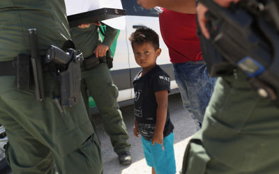 U.S. Border Patrol agents take into custody a father and son from Honduras near the U.S.-Mexico border on June 12, 2018 near Mission, Texas. The asylum seekers were then sent to a U.S. Customs and Border Protection (CBP) processing center for possible separation. Getty Images.