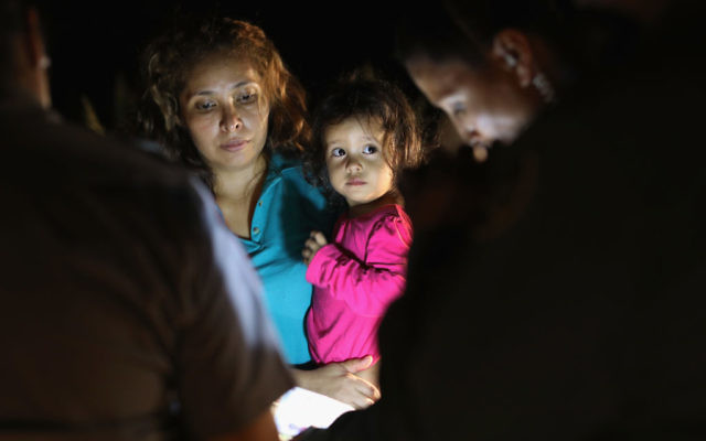 Central American asylum seekers, including a Honduran girl, 2, and her mother, are taken into custody near the U.S.-Mexico border on June 12, 2018 in McAllen, Texas. Getty Images
