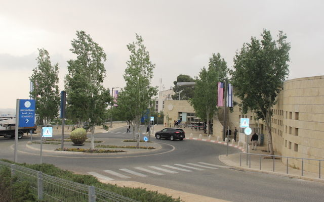 The U.S. Embassy in Jerusalem sits on a traffic circle recently named for President Donald Trump. The compound is in the middle of Arnona, a quiet residential neighborhood in the city's south. (Ben Sales)