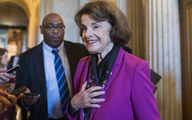 Sen. Dianne Feinstein talking with reporters in the Capitol building, June 5, 2018. (Tom Williams/CQ Roll Call)