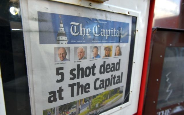 The Capital Gazette of June 29, 2018, is seen in a newspaper vending box in Annapolis, Maryland. - A man armed with a shotgun and smoke grenades burst into the newspaper office on June 28, killing five employees in what police described as a 'targeted attack.' Getty Images