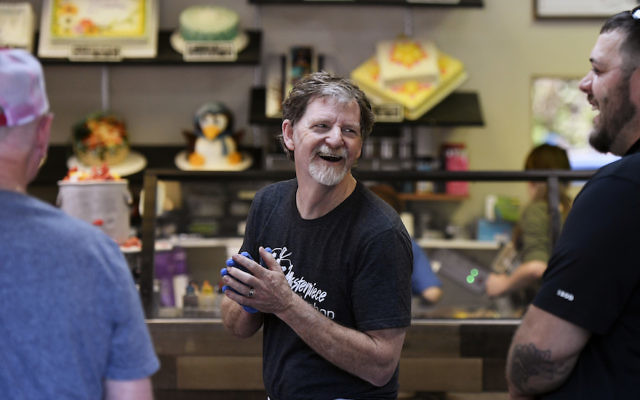 Jack Phillips, owner of the Masterpiece Cakeshop, celebrates in his Colorado store after the U.S. Supreme Court voted 7-2 in his favor in a dispute with a gay couple, June 4, 2018. (Joe Amon/The Denver Post via Getty Images)