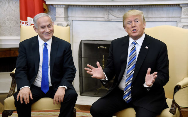 President Donald Trump gestures during a meeting with Israeli Prime Minister Benjamin Netanyahu in the Oval Office of the White House, March 5, 2018. Getty Images