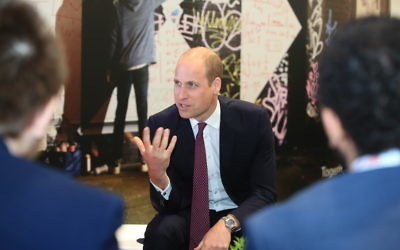 Prince William meets with schoolchildren at the Liverpool Exhibition Center in England, June 19, 2018. (Peter Byrne/WPA Pool/Getty Images)