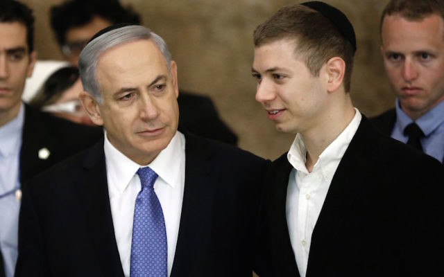 Israeli Prime Minister Benjamin Netanyahu, left, with his son Yair in Jerusalem, March 18, 2015. (Thomas Coex/AFP/Getty Images)