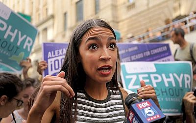 "Congressional nominee Alexandria Ocasio-Cortez campaigning in NYC. She says she views the Middle East ""through a human rights lens."" Getty Images"