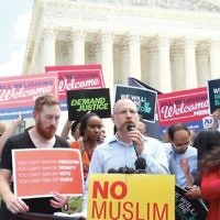 Rabbi Jason Kimelman-Block, Washington director of Bend the Arc, addresses a rally in front of the Supreme Court after the court's decision last week upholding President Trump's travel ban. The rally was held by a coalition of groups, some of them Jewish. Courtesy of Bend the Arc
