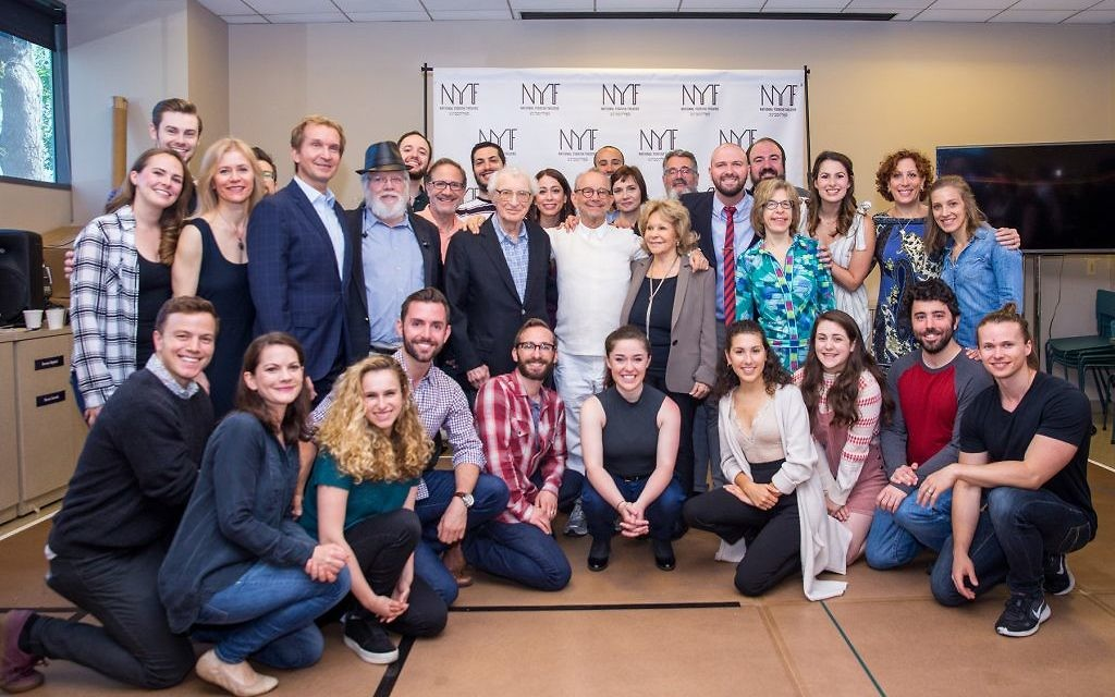 "The ""Fiddler on the Roof in Yiddish"" cast with director Joel Grey (in white) at center. Courtesy of Folksbiene"