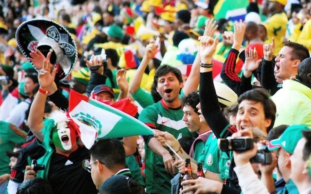 Mexican soccer fans at the 2014 World Cup. For the traveler, soccer is that rare common vocabulary that breaks the conversational ice all over the world. Wikimedia Commons