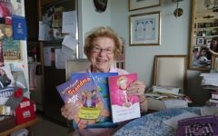 Dr Ruth holds up some of her books. Cathryn Prince via Times Of Israel