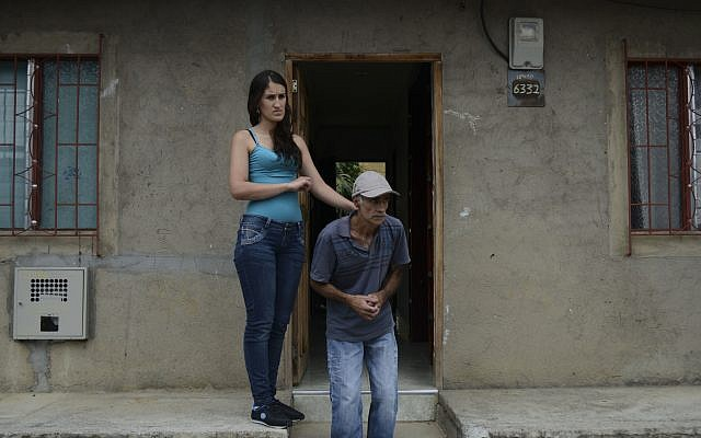 An Alzheimer's patient with his daughter. Courtesy of RAUL ARBOLEDA/AFP/Getty Images