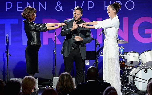 Magician David Blaine (C) performs onstage during the 6th Annual Sean Penn & Friends HAITI RISING Gala in California, January 7, 2017. Getty Images