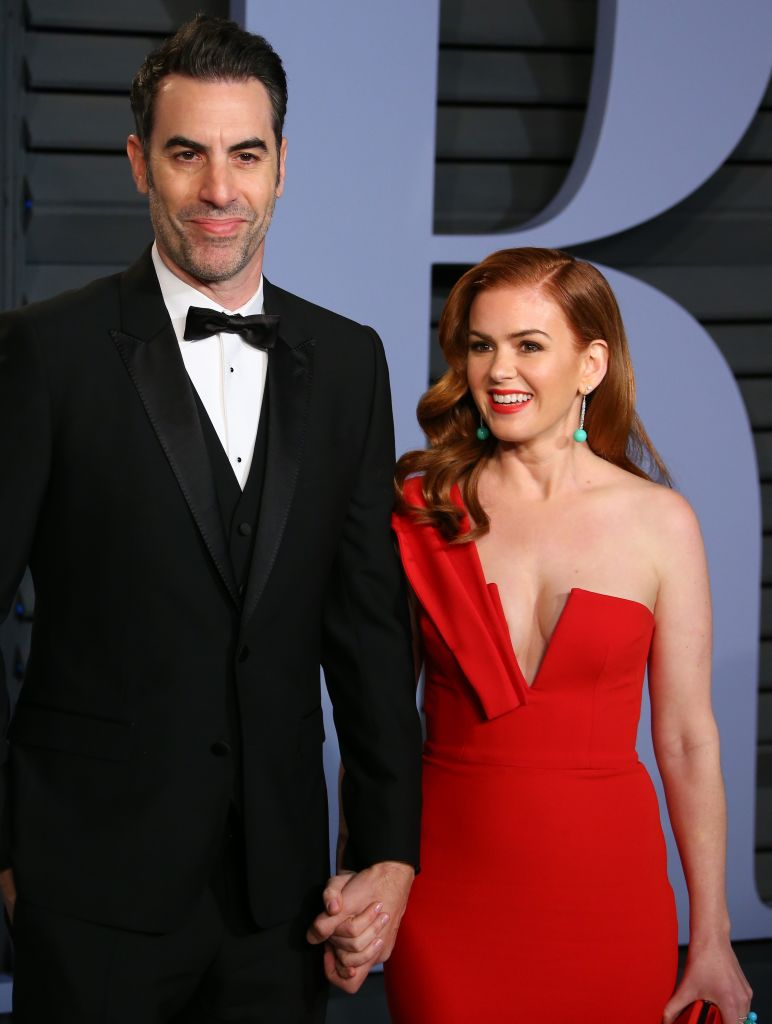 Sacha Baron Cohen and Isla Fisher attend the 2018 Vanity Fair Oscar Party. Getty Images