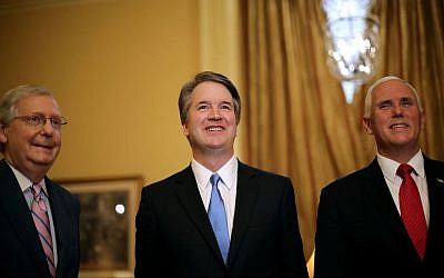 Judge Brett Kavanaugh (center), poses with Senate Majority Leader Mitch McConnell (R-KY) and Vice President Mike Pence before a meeting at the U.S. Capitol building today in Washington, DC. Getty Images