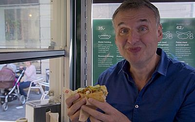 "Phil Rosenthal reacts as he taste tests food on ""Somebody Feed Phil."" Courtesy of Netflix"