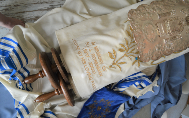 "This Torah, inscribed with the phrase ""Property of Cong. B'nai Jacob, Ottumwa, Iowa,"" has found a new home in Paraguay. (Courtesy of Amy Ravis Furey)"