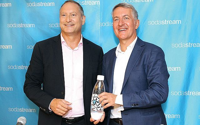 Break out the bubbly: SodaStream's CEO Daniel Birnbaum, left, and PepsiCo CEO Ramon Laguarta at this week's news conference in Tel Aviv. Getty Images