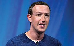 Facebook's Mark Zuckerberg: Lack of consistency on conspiracy theories? Getty Images