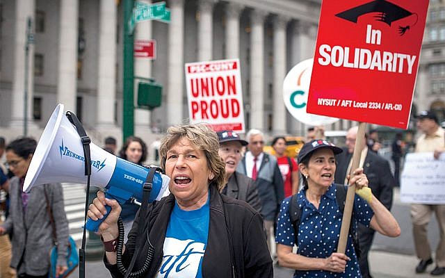 Randi Weingarten, with megaphone, marches last month in a pro-union rally here. Courtesy Professional Staff Congress