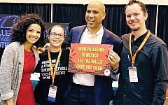 New Jersey Sen. Cory Booker is shown posing earlier this month with attendees at the Netroots Nation 2018 conference in New Orleans. @US_Campaign/Twitter