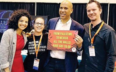New Jersey Sen. Cory Booker is shown posing earlier this month with attendees at the Netroots Nation 2018 conference in New Orleans. Screenshot Twitter / @US_Campaign