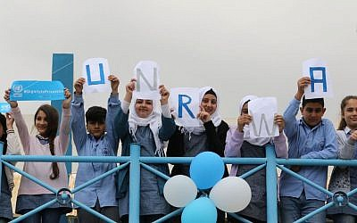 Students at a UNRWA school near the Lebanese border hold placards on March 12, 2018, during a protest against US aid cuts to the organization. Getty Images