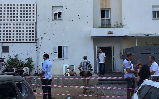 Buildings and cars in the southern Israeli city of Sderot were damaged by rockets fired from Gaza, Aug. 8, 2018. (JTA)