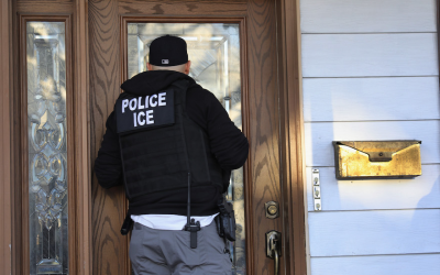 U.S. Immigration and Customs Enforcement officers arrive at a Brooklyn home in search of an undocumented immigrant, April 11, 2018. (John Moore/Getty Images)