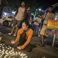 Young Israeli LGBT equality activists light candles at Zion Square in Jerusalem in solidarity with the victims of the shooting attack at Pulse, a gay night club in Orlando, Fla. (Photo by Hadas Parush/Flash90)