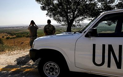U.N. peacekeepers looking out toward Syria from the Golan Heights, July 22, 2018. (Jalaa Marey/AFP/Getty Images)