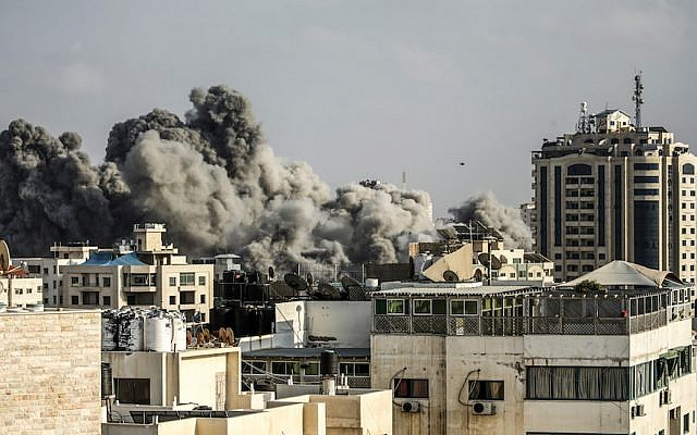 Smoke plumes rise following an Israeli airstrike in Gaza City in retaliation for Hamas rockets sent into southern Israel, July 14, 2018. (JTA)