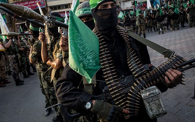 Hamas militants are seen during a military show in Gaza City. Getty Images