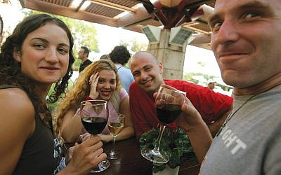 Young Israelis at a Golan Heights winery. Getty Images