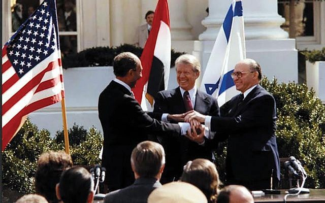 Egyptian President Anwar Sadat, President Jimmy Carter and Israeli Prime Minister Menachem Begin at the Camp David Accords ceremony at the White House in 1978. Wikimedia Commons