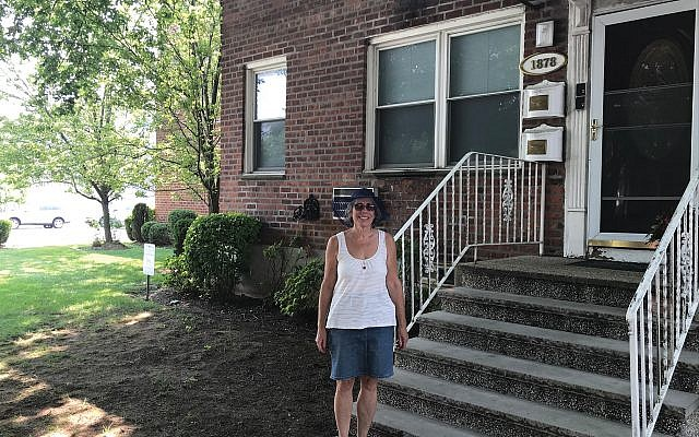 The author in front of the garden apartment in Marine Park where she grew up and where her parents began their family. Courtesy of Merrill Silver