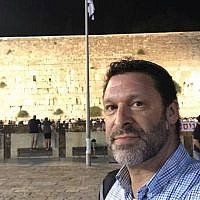 Ari Fuld, shown at the Western Wall in Jerusalem, worked at a nonprofit that provides food and supplies to Israeli soldiers. (JTA)