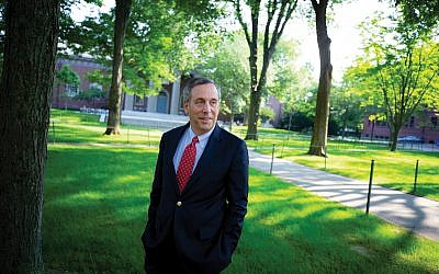 Lawrence Bacow, the 29th Harvard University president, walks through Harvard Yard on his first day in office in July. Rose Lincoln/Harvard Staff Photographer