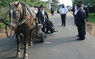 Rabbi Jehoshua Raskin shares a ride with other visitors to Lyubavichi, Russia, Aug. 26, 2018. (JTA)