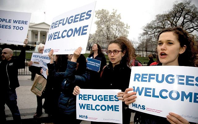 """Illustrative photo: HIAS activists at a """"Our People Were Refugees Too"""" rally in 2017. Jeff Malet/HIAS"""