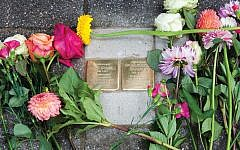 The Stolpersteine, or stumbling stones, for the author's relatives on a street in Amsterdam. Photos by Janiek Dam
