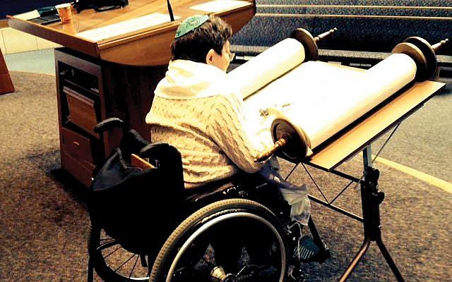 Minnesota disability activist Paula Fox, who died several years ago, using an adjustable Torah reading table.