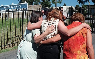 Three mothers of students who attend the North Valley Jewish Community Center in Granada Hills, Calif., walk together after addressing members of the press gathered following a shooting attack that injured five people in 1999. GETTY IMAGES