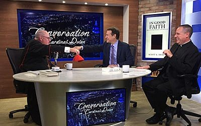 Scott Shay, center, with Cardinal Timothy Dolan, left, says the New Atheist, who are sharp critics of religion, don't understand the Bible. PHOTO COURTESY SCOTT SHAY