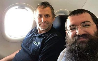 Rabbi Zalmen Wishedski, right, wrote a Facebook post about his conversation with a German man who travels to Israel to renovate Holocaust survivors' apartments. (JTA)
