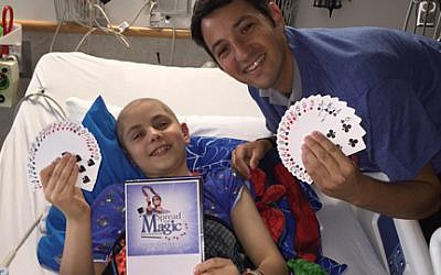 Chad Juros with his magician apprentice, Carter Suozzi. Courtesy of Chad Juros